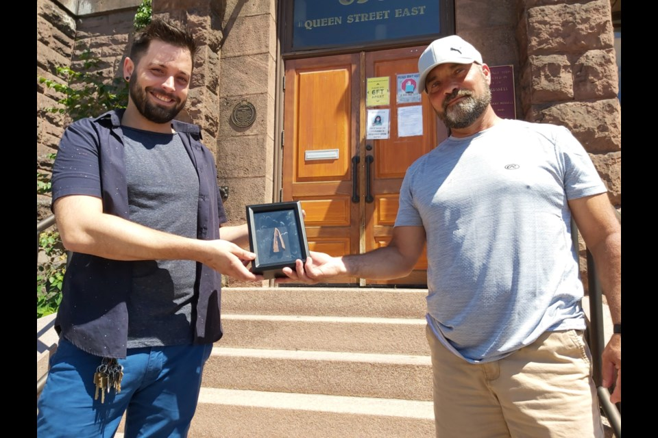 Rob Gioia (right), Sault metal detector enthusiast, donates a copper object, possibly a spear tip, which he discovered on the shores of the St. Marys River and verified as being 3,000 to 5,000 years old, in a shadow box to William Hollingshead, Sault Ste. Marie Museum executive director and chief curator, July 24, 2020. Darren Taylor/SooToday