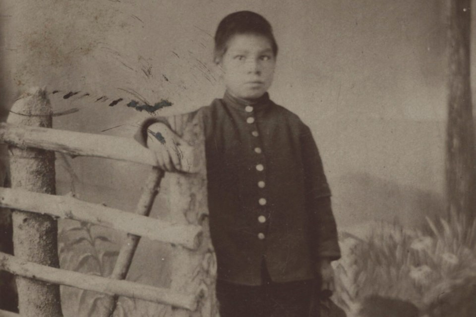 Undated photograph of young boy from Shingwauk Mission in Sault Ste. Marie, Ont.