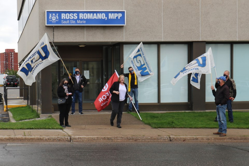 Unifor Local 1359 President Cathy Humalamaki addresses supporters outside Sault MPP Ross Romano's office Wednesday. Union representatives are demanding improved pay and working conditions for personal support workers locally. James Hopkin/SooToday