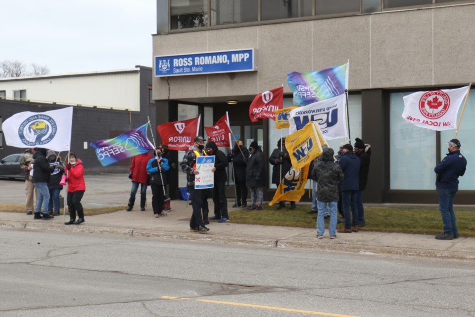 Representatives from a number of local unions joined Sault Ste. Marie and District Labour Council outside of College and Universities Minister Ross Romano's constituency office to call for long-term funding for Laurentian University.