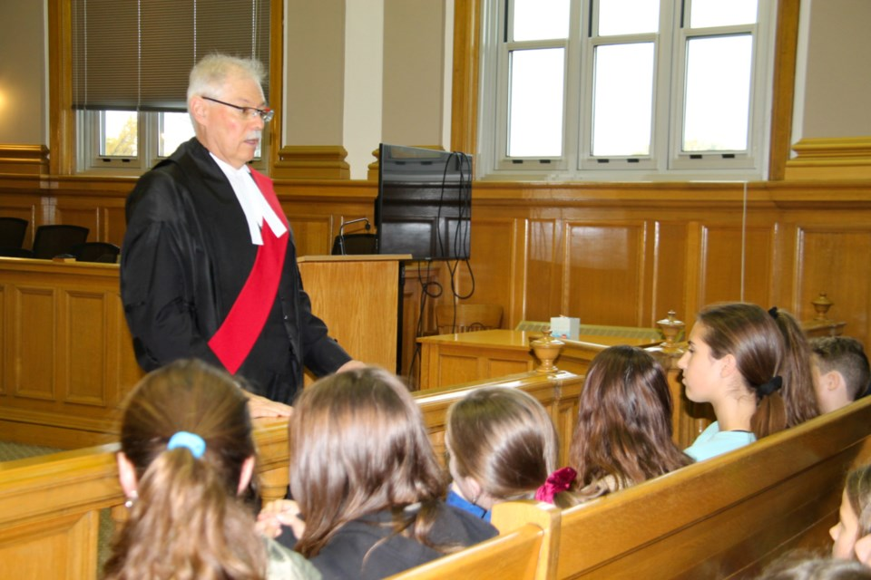 Justice Paul Condon addresses students at the second annual Access to Justice education event for elementary school students held at the Sault Ste. Marie Courthouse, Oct. 22, 2019. Darren Taylor/SooToday