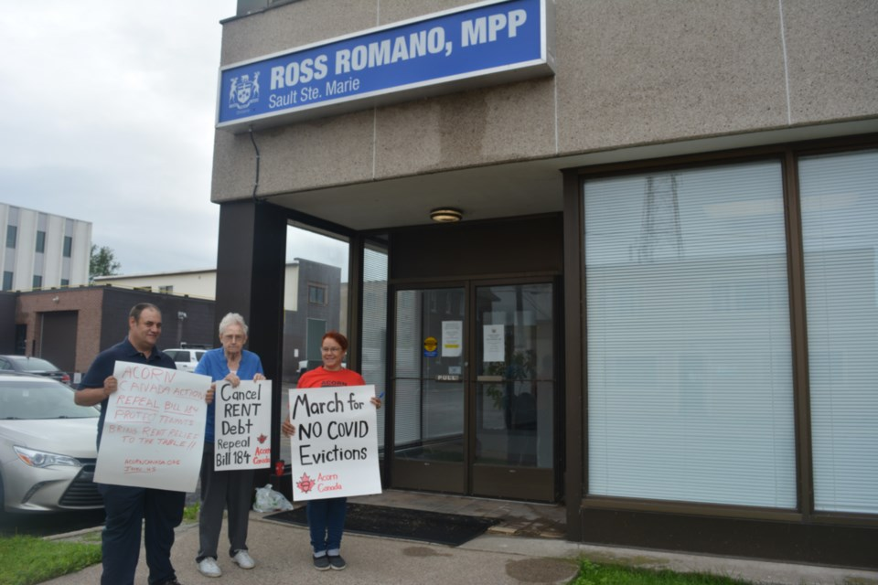 Three local members of ACORN Canada were seen protesting pandemic evictions and Bill 184 outside the office of Sault Ste. Marie MPP Ross Romano Wednesday. Left to right: Scott Parsons, Nancy Callow and Josie Weir. Drew Armstrong/SooToday
