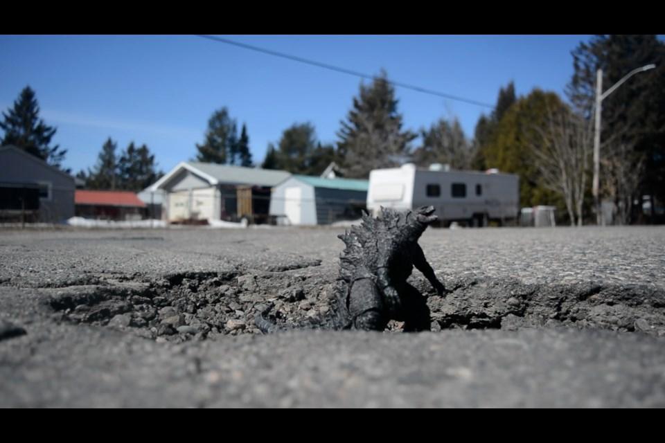 Godzilla in pothole. Mission accomplished?