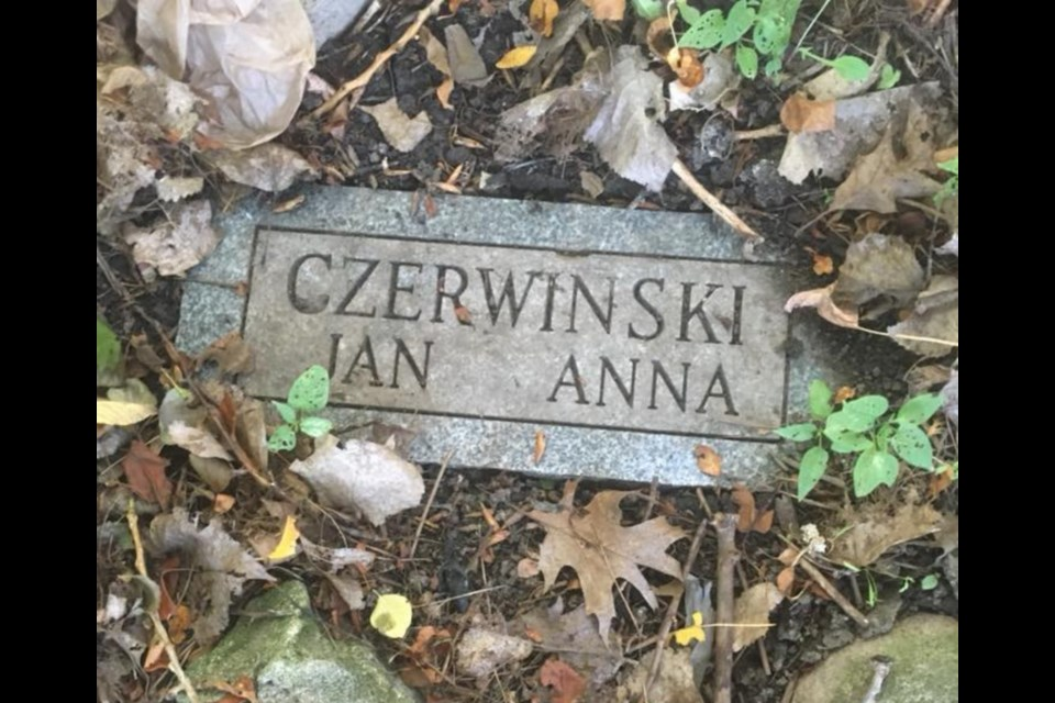 Monique Carroll found this plaque in her backyard in July. Members of the former Seventh-day Adventist Church on Cunningham Road say that the ashes of Jan and Anna Czerwinski are buried underneath. Photo supplied