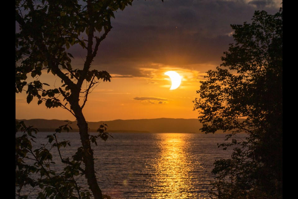 The eclipsed – or 'horned' – sunrise on Thursday, June 10, 2021 as seen from Marlette Bay, Goulais River