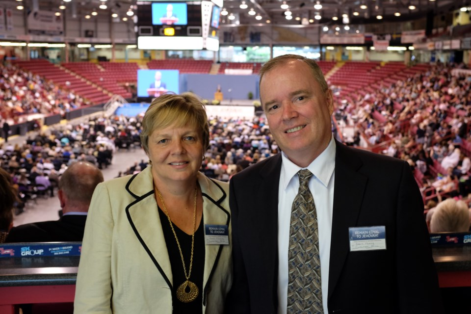 Robert Fleming and his wife Karen at a the annual Northern Ontario Convention of Jehovah's Witnesses in Sault Ste. Marie last week. Fleming hadn't been to the Sault in 20 years after he and his wife left for Africa in 1996. Photo by Jeff Klassen for SooToday