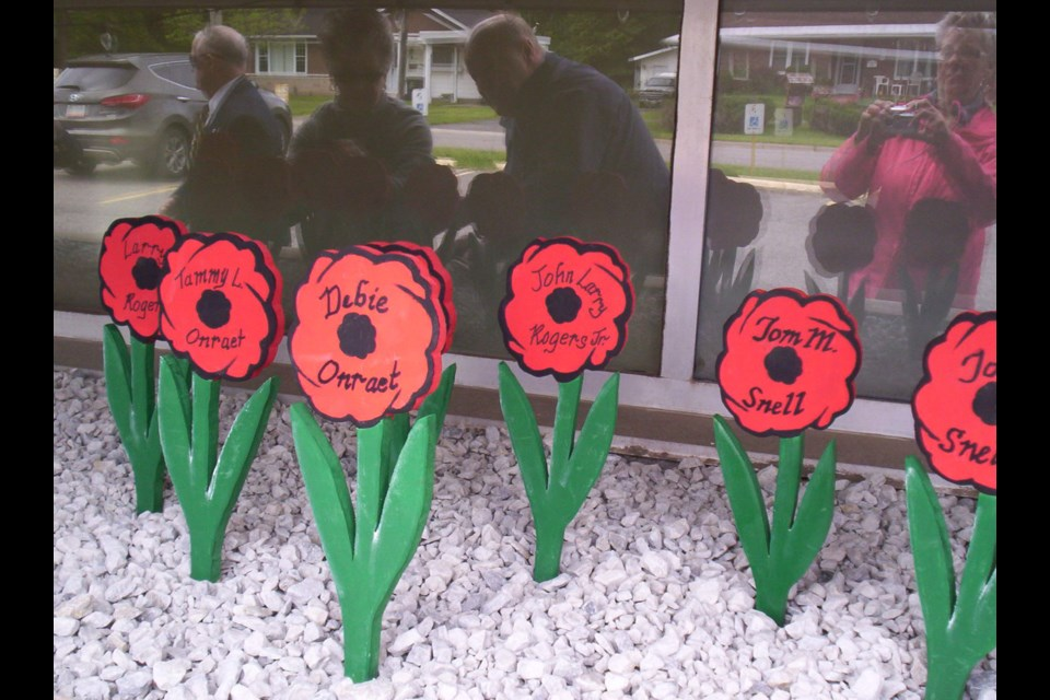 Royal Canadian Legion Branch 25 members planted wooden poppies in memory of veterans and other loved ones Monday June 6, 2016.  Photo supplied by Helen Stewart, Royal Canadian Legion Branch 25.