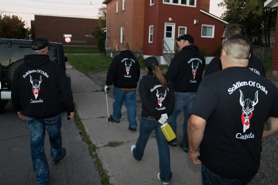 The controversial group Soldiers of Odin are now walking the streets and alleys of Sault Ste. Marie. On Wednesday they were out cleaning up discarded drug needles off the streets while wearing their notorious black uniforms emblazoned with the groups logo. Jeff Klassen/SooToday
