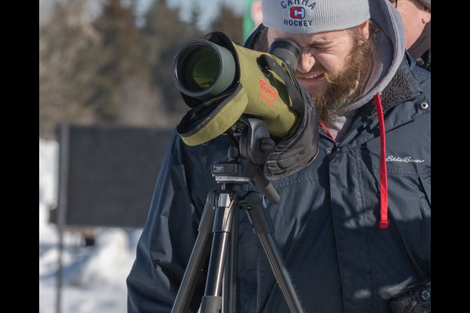 Carter Dorscht, of Dorscht Birding, scoping the distant Gyrfalcon. Violet Aubertin for SooToday