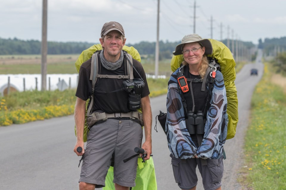 Sean Morton and Sonya Richmond stop to pose for a photo as they approach the Sault from the east. Violet Aubertin for SooToday