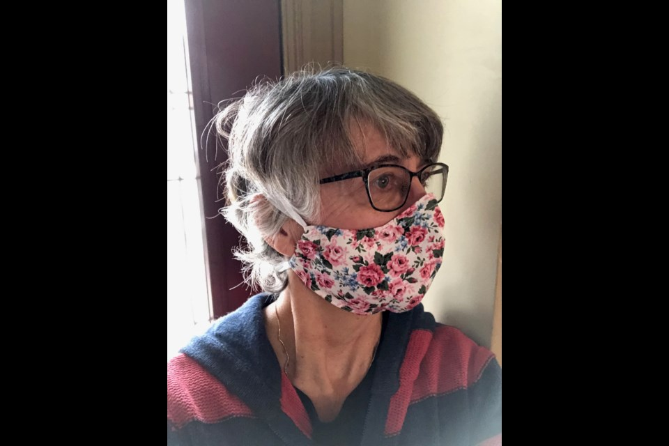 Geri Turchet models one of the masks she has made. Photo supplied