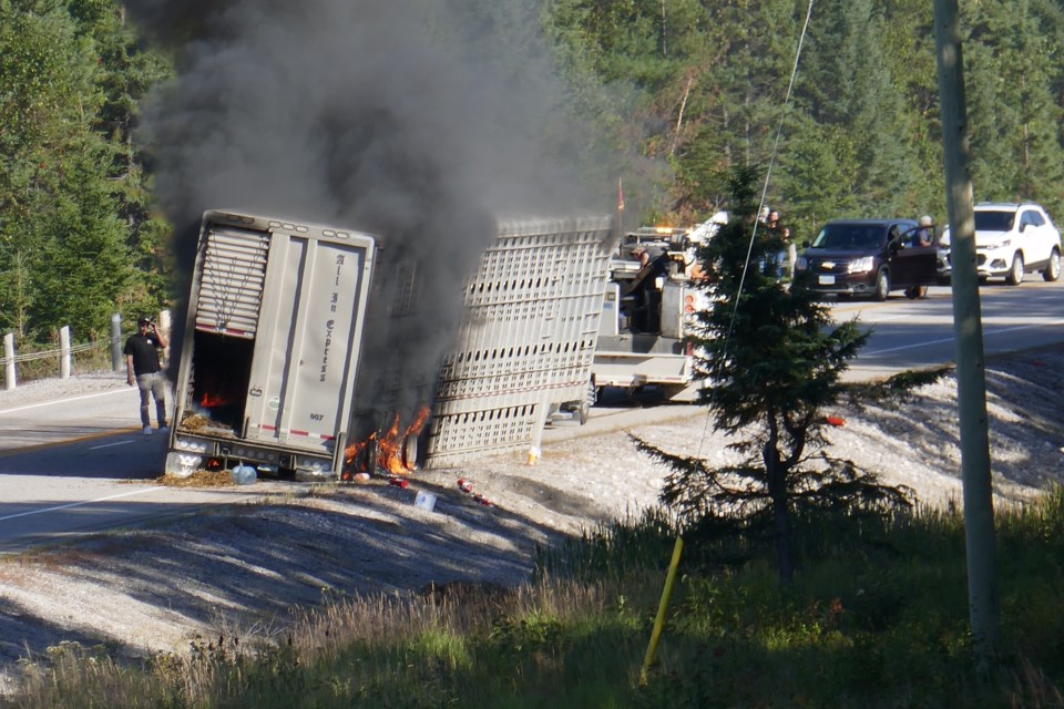 Reader submitted photo shows cattle trailer burning in the eastbound lane of Highway 17 west of Montreal River