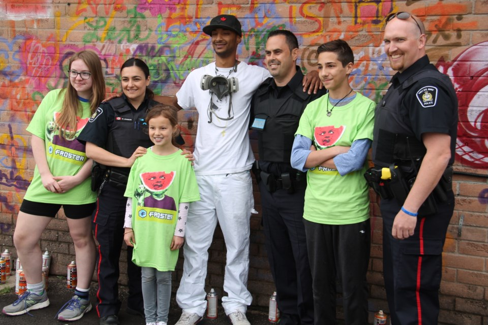 Sault Police, Mac's Convenience Stores, local students and Toronto artist Magic Finnga Wong teamed up to launch a 'graffiti as art' program at the Mac's location at 647 Second Line West to cut down on crime, June 19, 2017.  Darren Taylor/SooToday