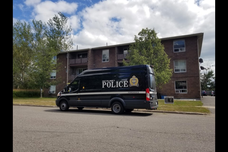 A Sault Ste. Marie Police Service forensics van parked outside 171 Breton Rd., Aug. 25, 2019. James Hopkin/SooToday