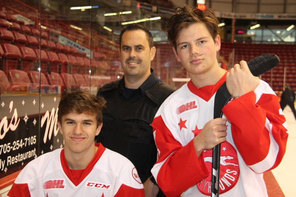 Jacob LeGuerrier and Barrett Hayton of the Soo Greyhounds with Cst. Sonny Spina, Oct. 25, 2017. Darren Taylor/SooToday