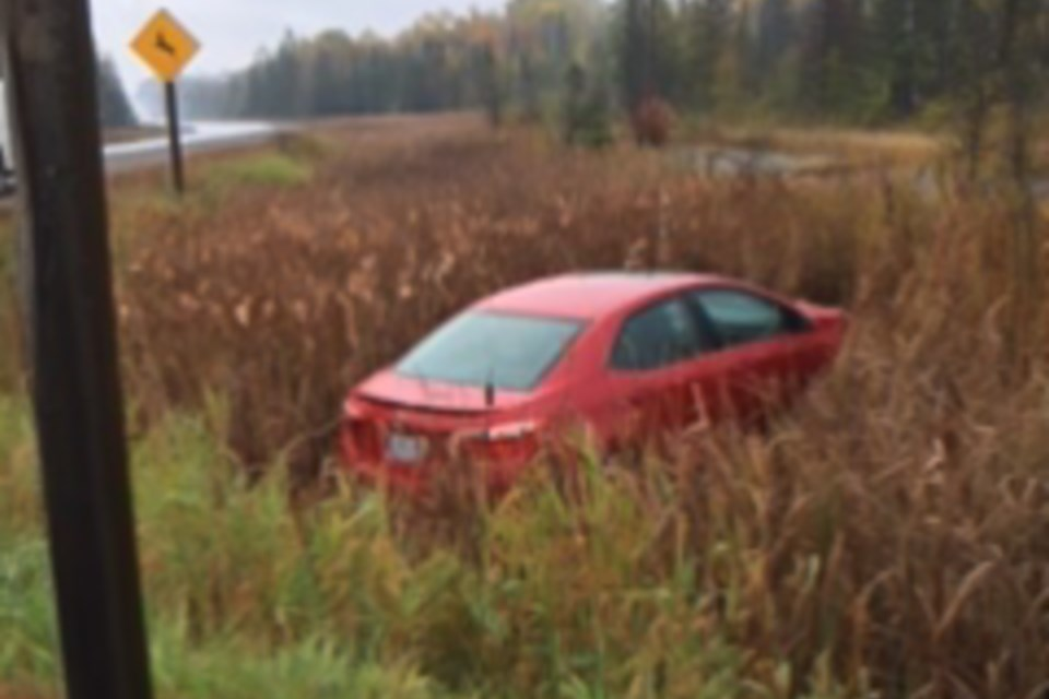 A red sedan rests in a ditch off Highway 17 near Thessalon on Oct. 7. Marianne Giguere, 58, of Thessalon First Nation was charged with impaired driving after a single vehicle motor collision on Oct. 10, say OPP. Reader submitted photo