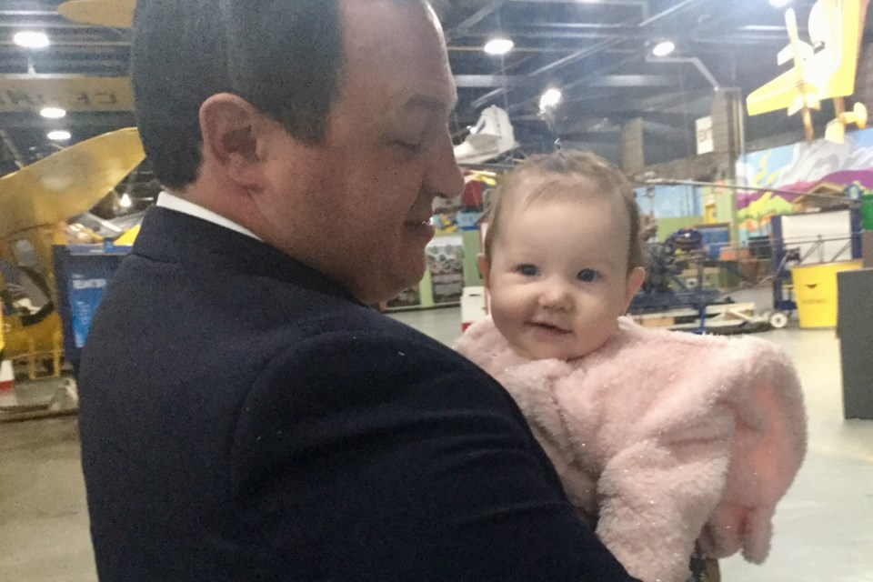 Mayor Christian Provenzano unwinds with Alice, youngest of his three daughters, after delivering his State of the City Address at Canadian Bushplane Heritage Centre on Thursday, Oct. 3, 2019. David Helwig/SooToday