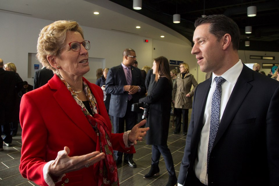 Kathleen Wynne, premier of Ontario, speaks with David Orazietti Jan. 26, 2017 during a funding announcement at Sault College. Formerly the MPP for Sault Ste. Marie, Orazietti is now the Dean of Aviation, Trades and Technology, Natural Environment and Business at Sault College. Kenneth Armstrong/SooToday
