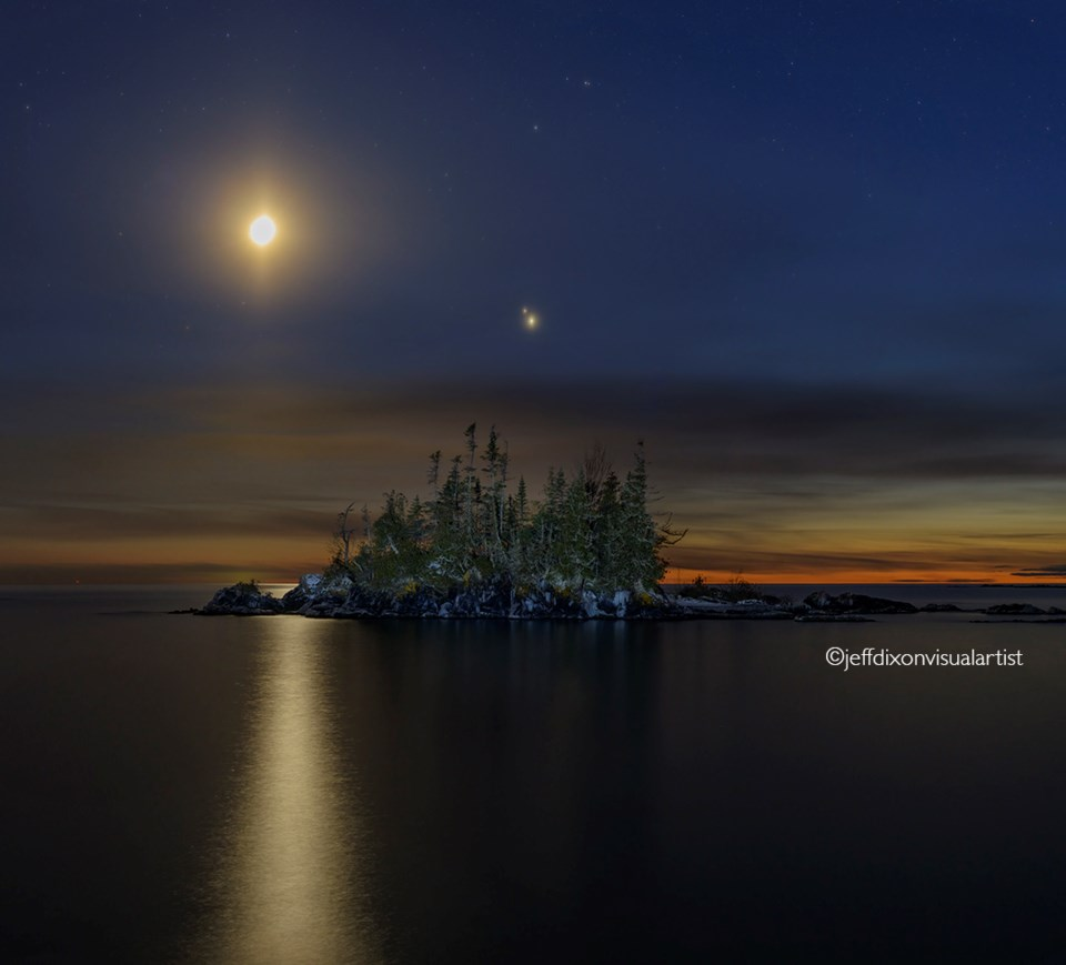 Jupiter and Saturn a few days away from their once-in-800-year conjunction captured over Lake Superior on Thursday night