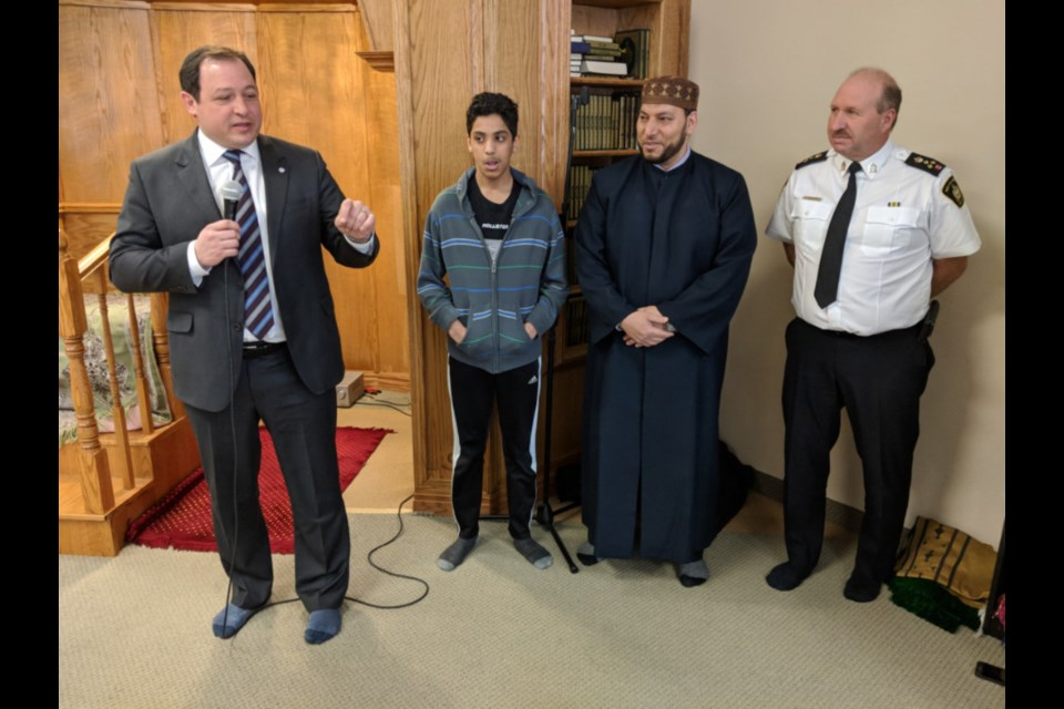 Sault Mayor Christian Provenzano, Muammar Amhalhal, Savr Alkiakei, Islamic Association of Sault Ste. Marie Imam, and Sault Police Chief Hugh Stevenson at the Islamic Association of Sault Ste. Marie mosque, the mayor and chief voicing support for the Sault's Islamic community after 49 people were killed in attacks on two mosques in New Zealand, March 15, 2019. Darren Taylor/SooToday