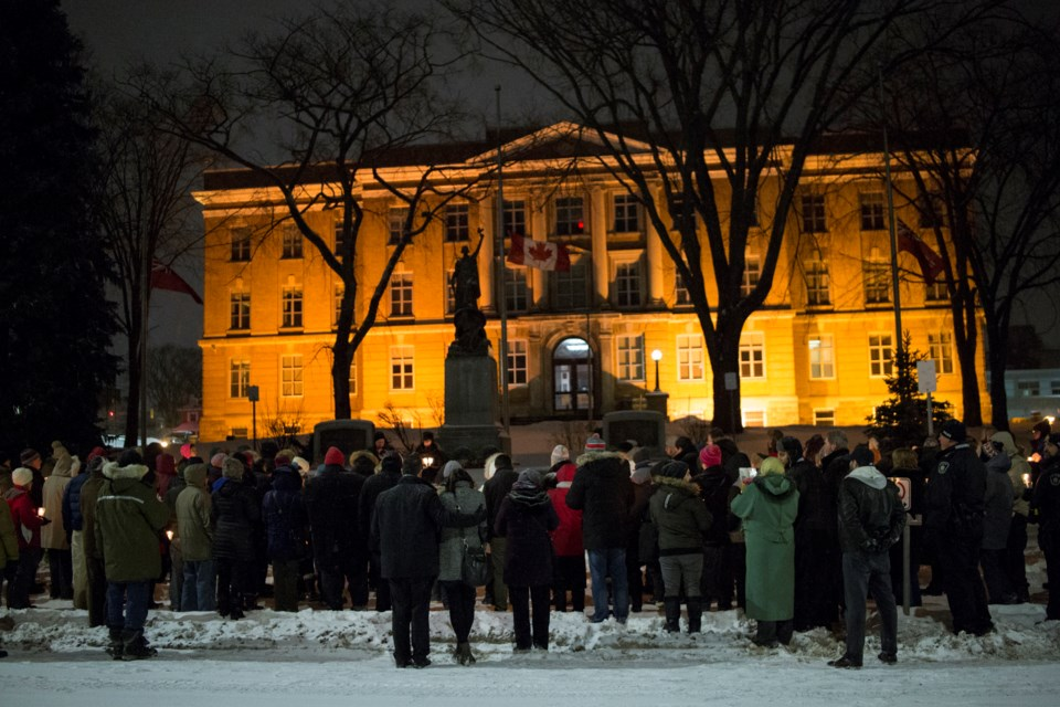 People seen holding lit candles during a vigil Feb. 1, 2017 at the courthouse in support of the local Muslim community. Kenneth Armstrong/SooToday