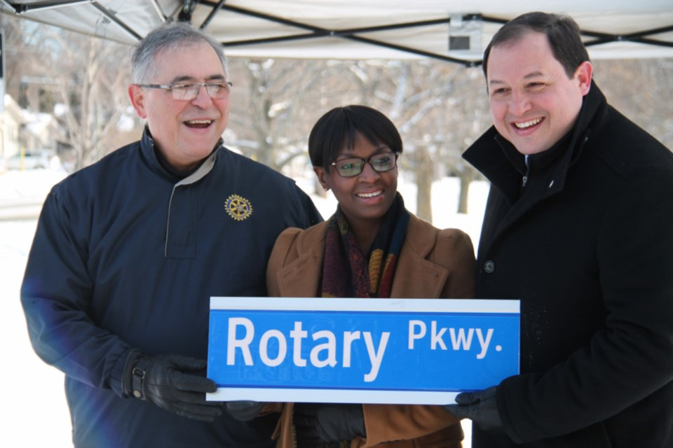 Robert Carricato, current Rotary Club of Sault Ste. Marie president, and Melinda Mills, past Rotary Club of Sault Ste. Marie president, join Sault Mayor Christian Provenzano at the official naming ceremony for Rotary Parkway, Nov. 20, 2018. Darren Taylor/SooToday
