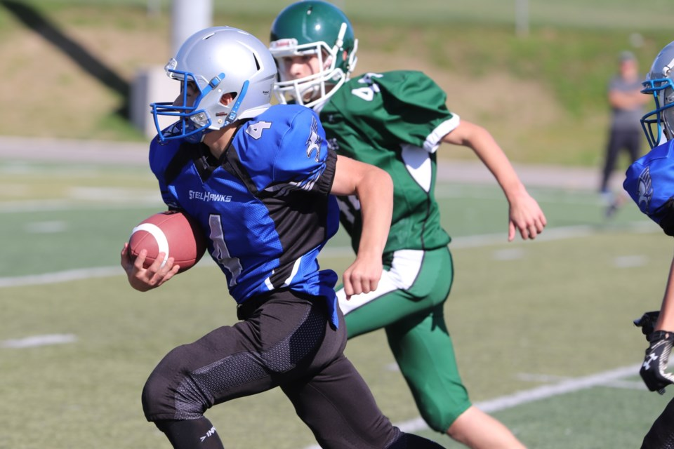 Action from Saturday's junior football game between Superior Heights and White Pines. Brad Coccimiglio/SooToday