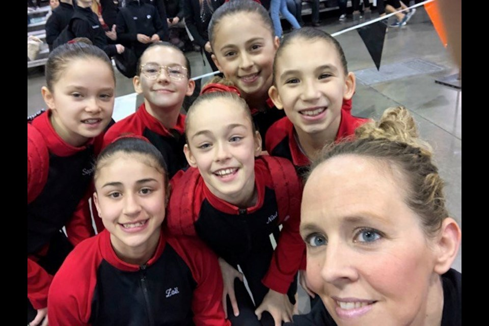 Kim Bonnell with a group of young gymnasts. A promising young athlete herself, Bonnell has embraced coaching. Photo supplied