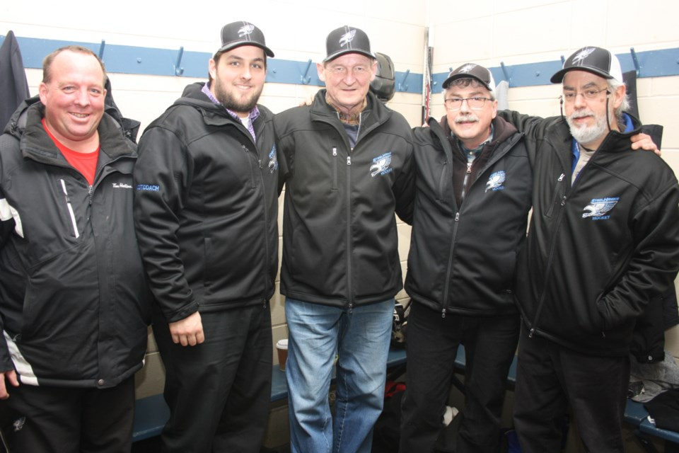 Remi Gentes with coaches. Supplied photo
