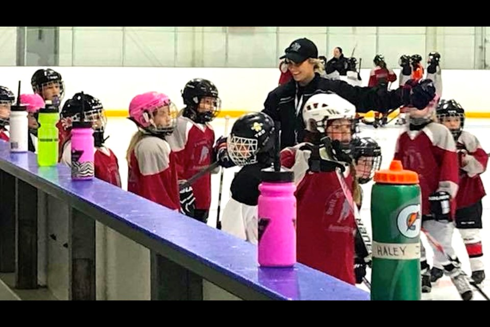 Brianne Veale works with girls enrolled in her Northern Elite Female Hockey Academy. photo supplied