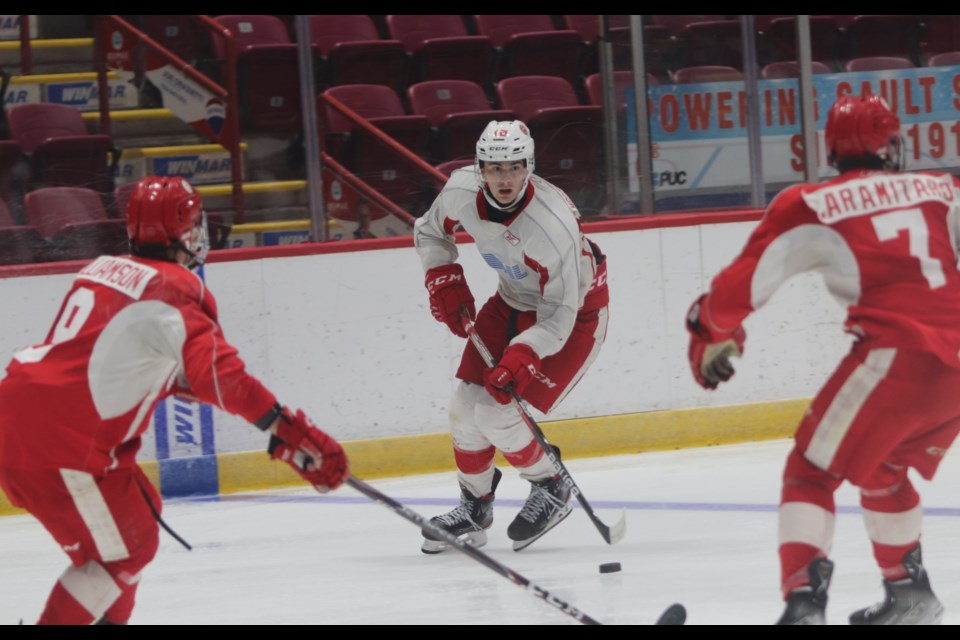 2020 first round pick Bryce McConnell-Barker (white jersey) in action during the Soo Greyhounds 2021 training camp.
