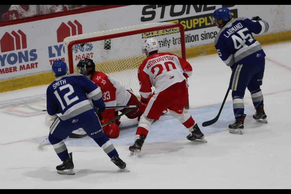 Ryan Smith of the Sudbury Wolves beats Soo Greyhounds goaltender Samuel Ivanov in a game at the GFL Memorial Gardens on Oct. 9, 2021.