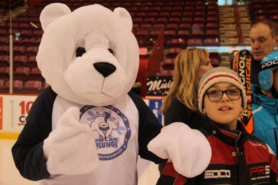 Athlete Miguel Bedard with Plungey the Polar Bear, Special Olympics Ontario 2019 Provincial Winter Games mascot at the Essar Centre, Jan. 30, 2018. Darren Taylor/SooToday
