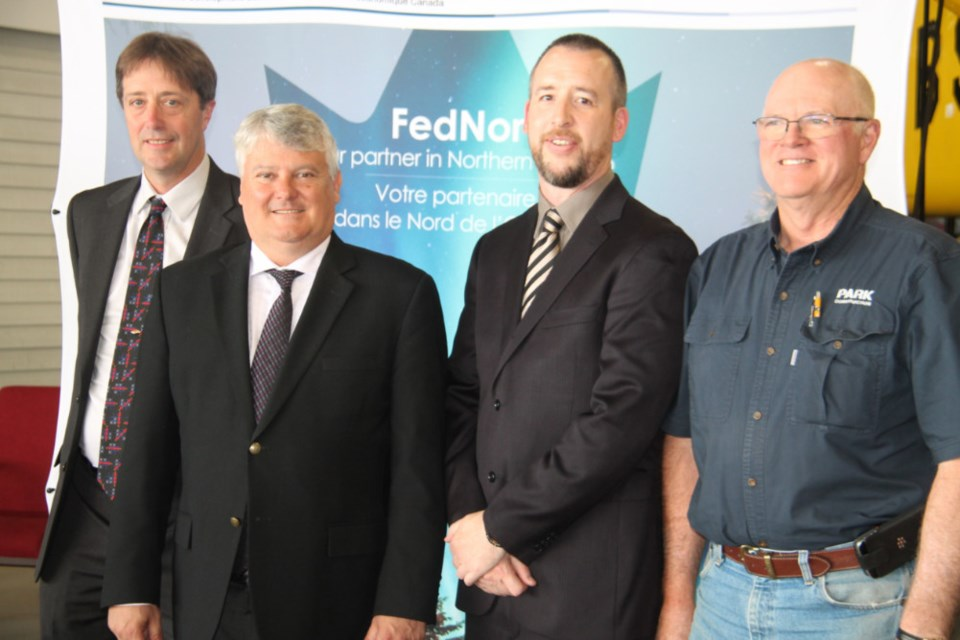 Dan Ingram, Canadian Bushplane Heritage Centre executive director, Terry Sheehan, Sault Ste. Marie MP, Todd Fleet, the centre's curator, and Kim Park, the centre's board of directors chair, at a federal funding announcement of $438,000 for a major renovation for the museum, June 27, 2018, Darren Taylor/SooToday
