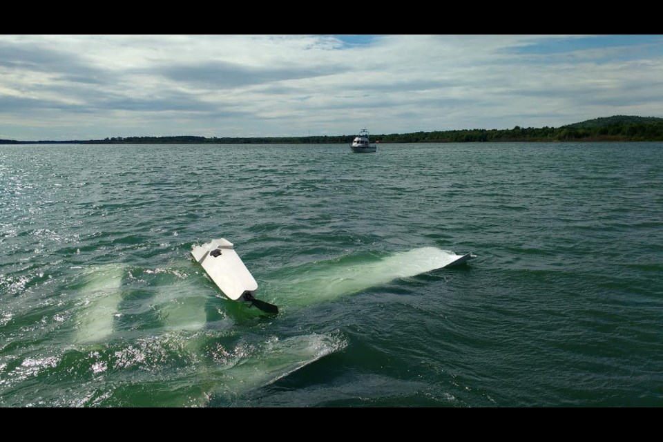 Two Sault men towed this plane back to shore after it flipped over in the St. Marys River Monday.  Photo submitted by David West.