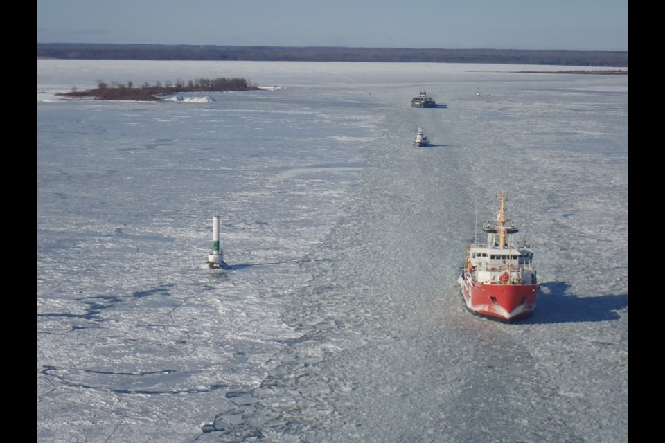The Canadian Coast Guard Ship Samuel Risley escorted commercial vessels through the West Neebish Channel of the St Marys River south of Sault Ste. Marie Ontario December 30 2017. Photo taken from aboard a Canadian Coast Guard helicopter. Photo provided.