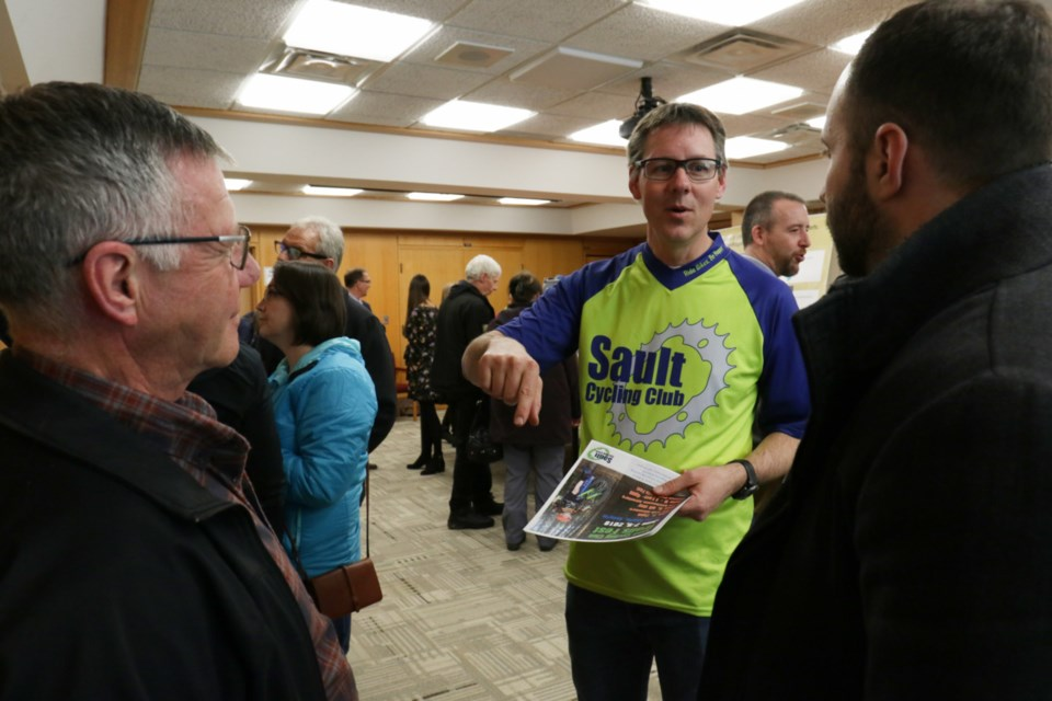 Sault Cycling Club Trail Director Peter Henry (middle) speaks with people attending Thursday night's public info session about the proposed Farmer Lake Mountain Bike Trail Network. James Hopkin/SooToday