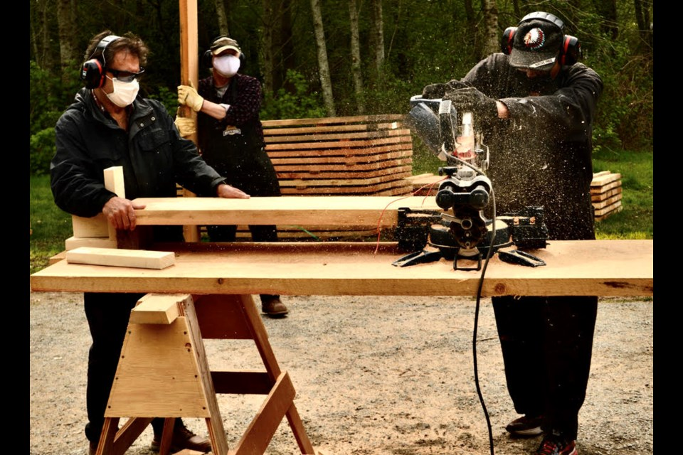Robert Goluch (left) working on a Squamish Men's Shed project.