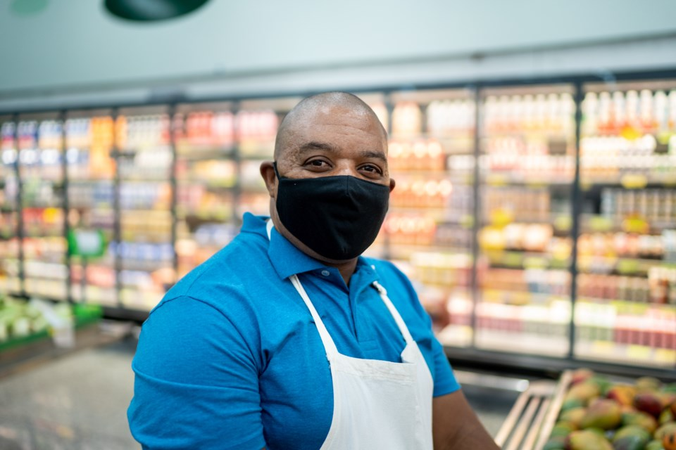 Grocery store worker.