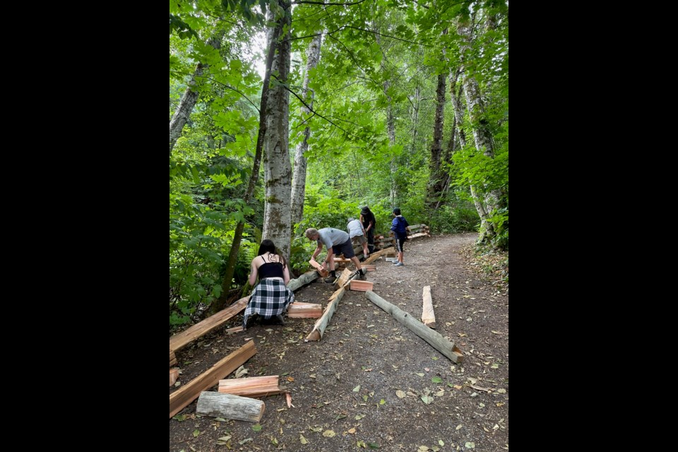 Volunteers put up the fence at Coho Park on Monday, Aug. 16.