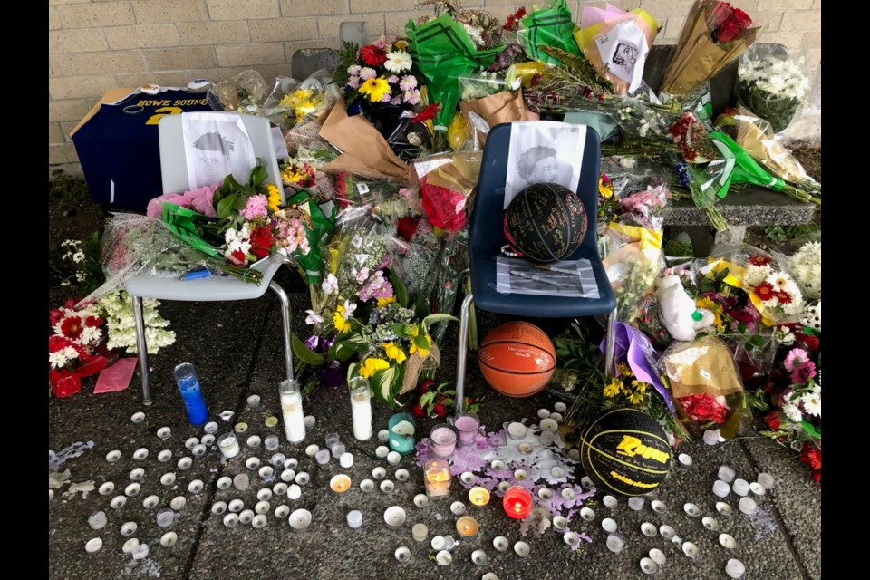 A memorial to Squamish's 17-year-old Alex Reyes continues to grow at the entrance to Howe Sound Secondary.