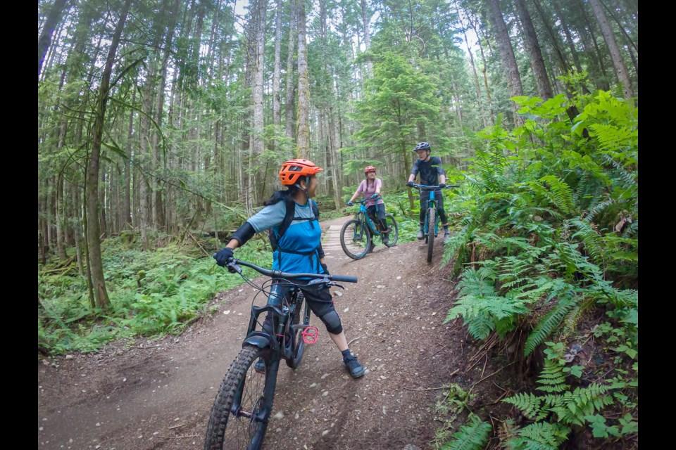 A family biking on Squamish trails.