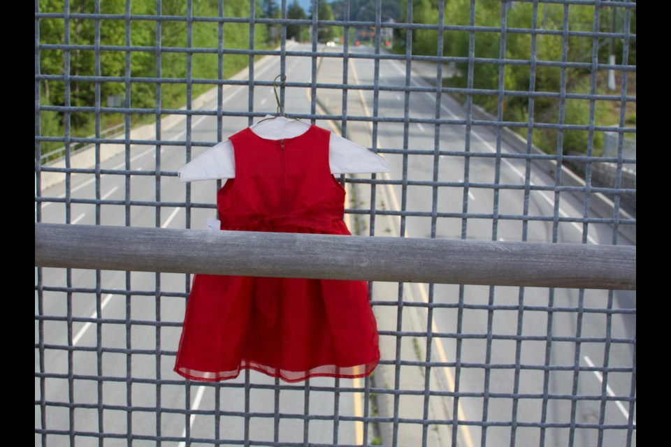 A dress hangs on the overpass by Totem Hall to honour National Day of Awareness for Missing and Murdered Indigenous Women and Girls Day, May 5.
