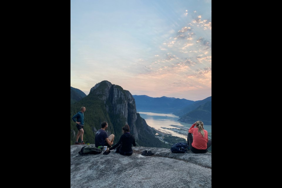A contingent of Capra Running Co. group members look out over Howe Sound as part of a pre-pandemic outing.