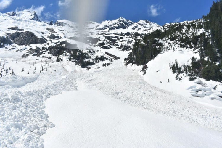 On Sunday, an avalanche swept through the Tantalus Traverse, stranding a party of three backcountry skiers.