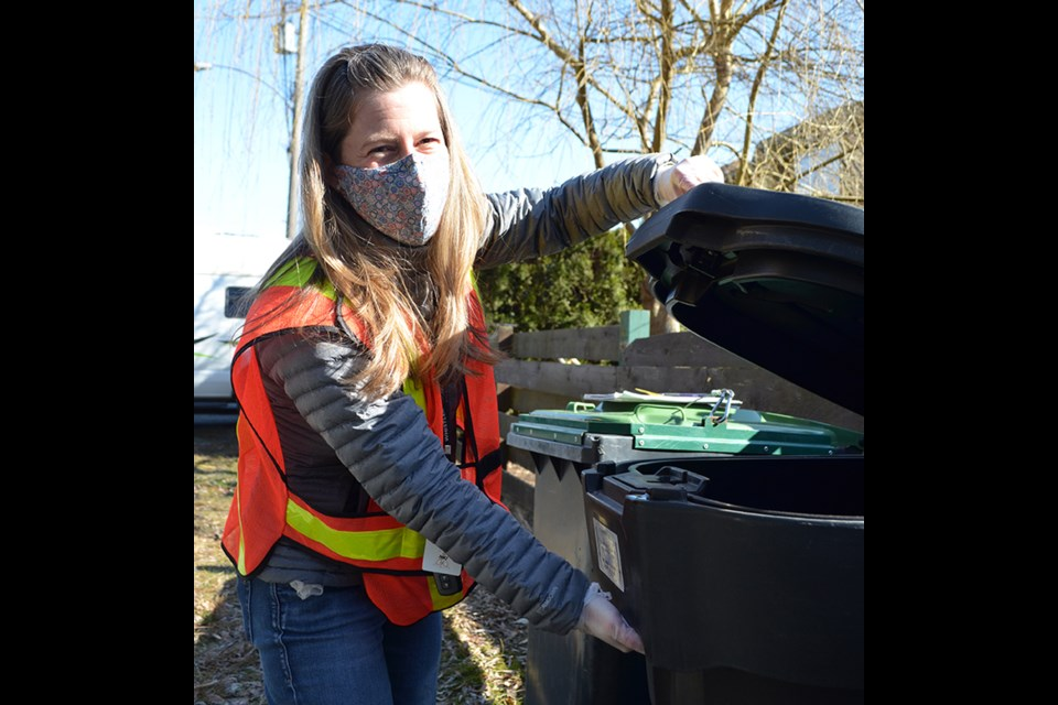District of Squamish wildlife officer Meg Toom shows off some of the new bear-resistant totes being piloted by the municipality.