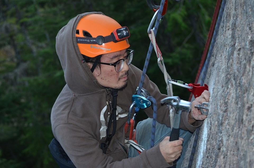 Steven Chua climbing