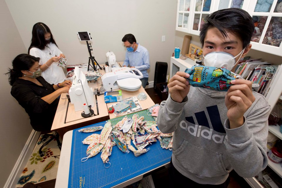 YOU'LL NEED THESE — St. Albert Public, GSACRD, and Centre-Nord students will need to wear masks in school under many circumstances this fall. Shown here is the Cheung-Liu family of Sturgeon County, who sewed and donated 1,000 masks to Sir Alexander Mackenzie Elementary in August 2020. KEVIN MA/St. Albert Gazette
