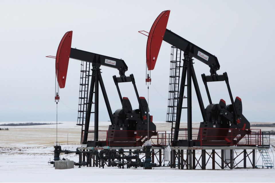 Two pumpjacks frame a picturesque farm in Kneehill County near Three Hills, Alta., on Tuesday, Feb. 4, 2020. CLAIRE THEOBALD/Photo