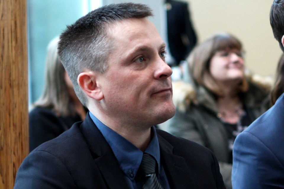 Nate Horner, MLA for Drumheller-Stettler, listens to an announcement inside of the Edmonton Federal Building on Thursday, Feb. 6, 2020. CLAIRE THEOBALD/Photo
